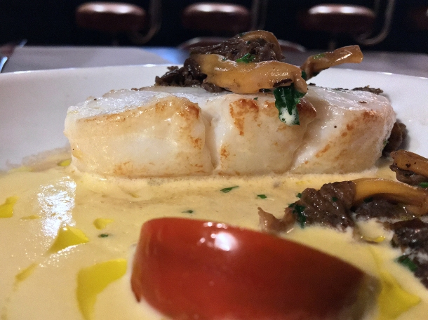 illustrative photo of the cod with mushrooms and tomato at Opera Tavern