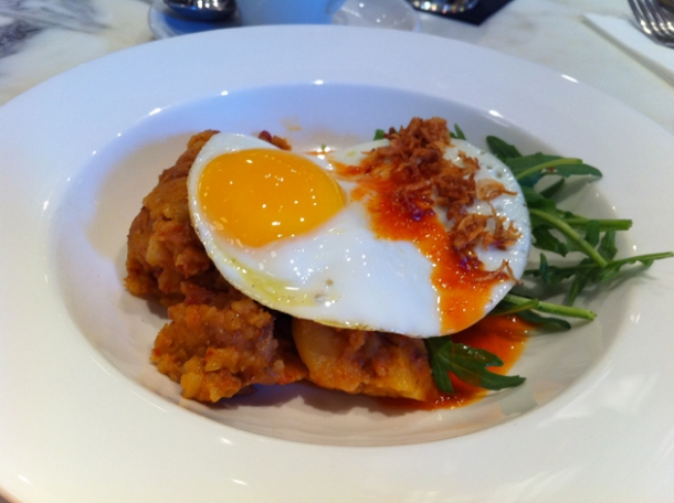 chorizo hash with a fried egg, rocket, salsa verde & crispy shallots