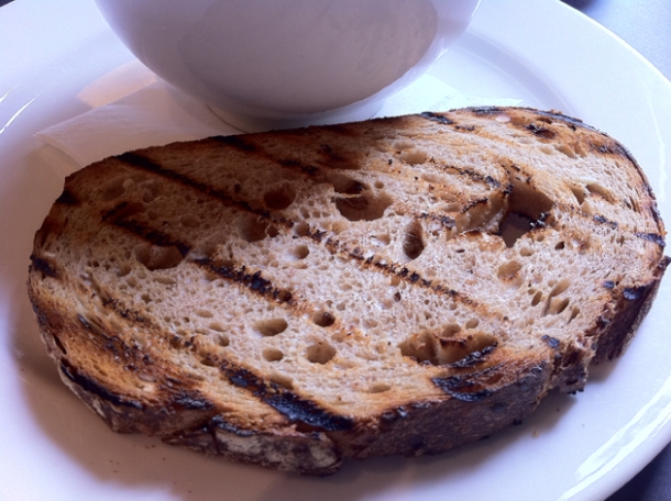 The brown toast that comes with the Turkish Eggs at Kopapa