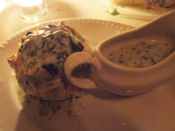 white fish and spinach knish with parsley liqour at mishkin's
