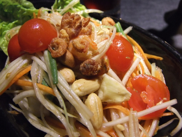 classic spicy papaya salad with cherry tomatoes and roasted nuts at suda