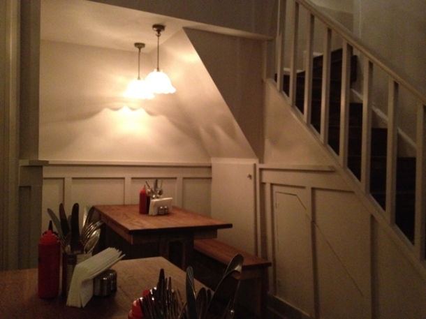 table for four under the stairs at pittcue soho