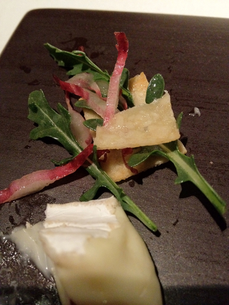 brie with endive leaves in pine nut wafers at moments mandarin hotel barcelona