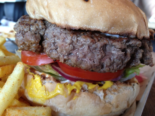 close up of burger at duke's brew and que