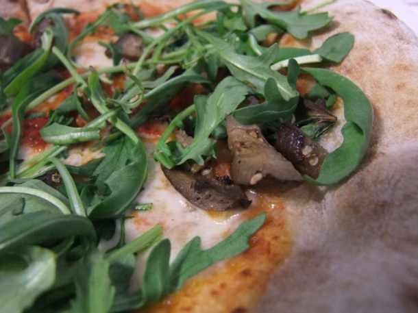 close up of eggplant and rocket pizza pilgrims