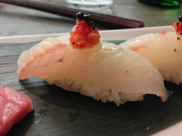 gurnard nigiri sushi with onion, tomato and pepper salsa at dinings