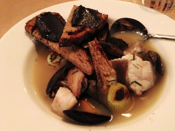 fish broth with squid ink mayonnaise on toast at season