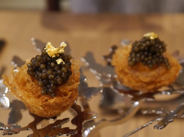 quail egg puff topped with caviar and gold leaf at bo london