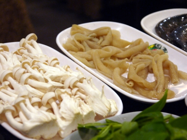 raw intestines and enoki mushrooms at Tian Xiang Huwei Hot Pot