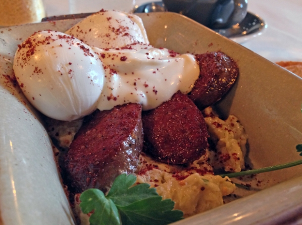 aubergine puree, poached eggs, yoghurt, parsley and toast with soutzouki sausage at caravan kings cross