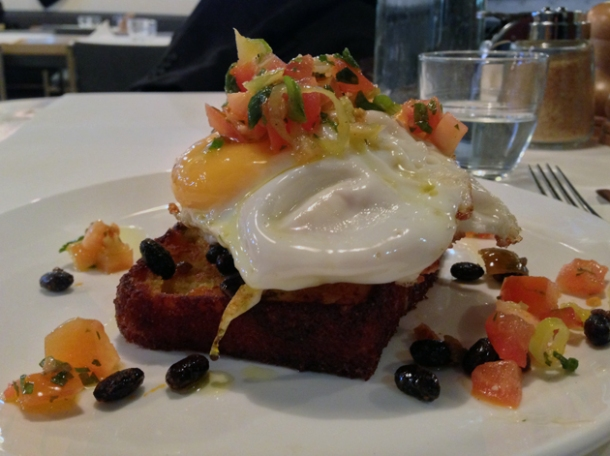 jalapeño corn bread, fried eggs, black beans and pepper at caravan kings cross