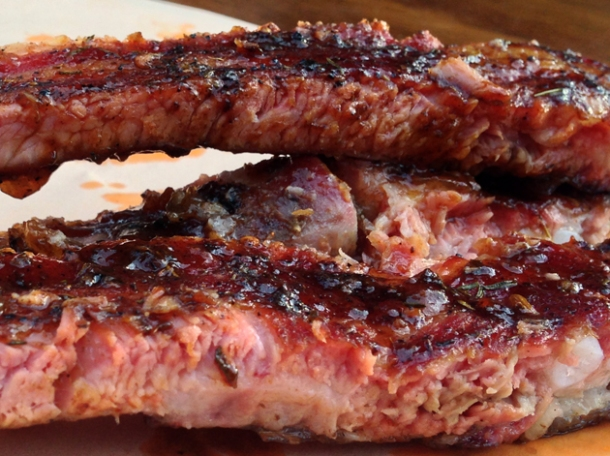 close up of st louis cut spare ribs from smokestak