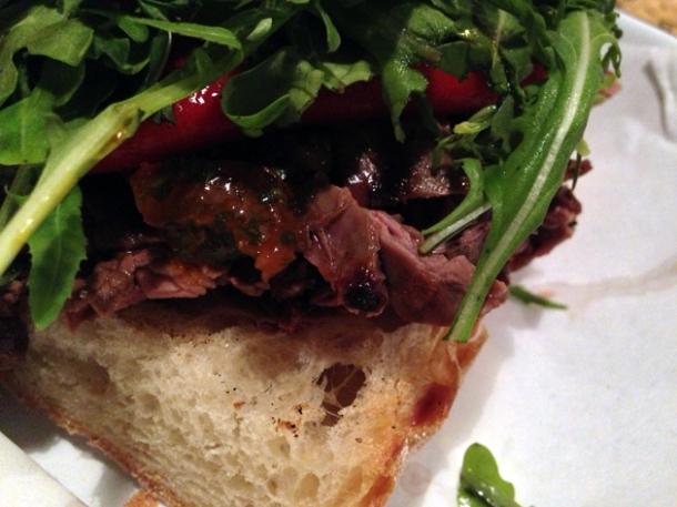close up of steak sandwich at mamita que chorizo