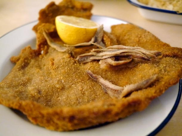 wiener schnitzel topped with anchovies at boopshi's