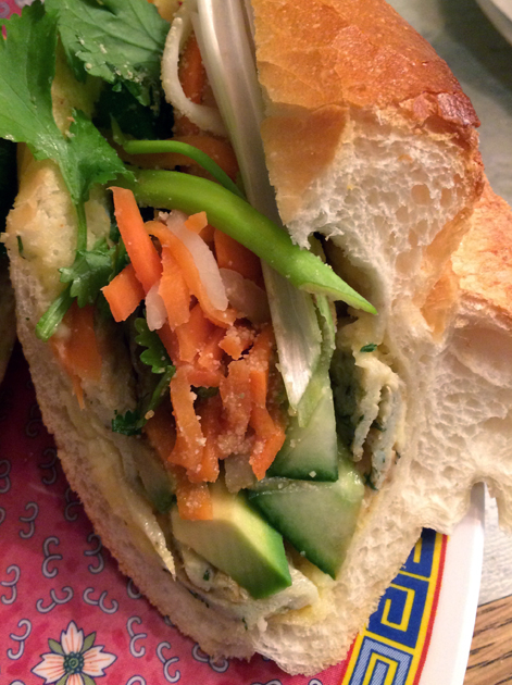 close up of avocado and omelette banh mi at miss chu