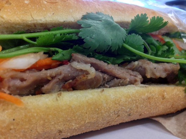 close up of spiced pork baguette at banh mi bay