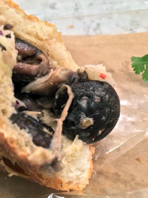 close up of mushroom banh mi at bep haus