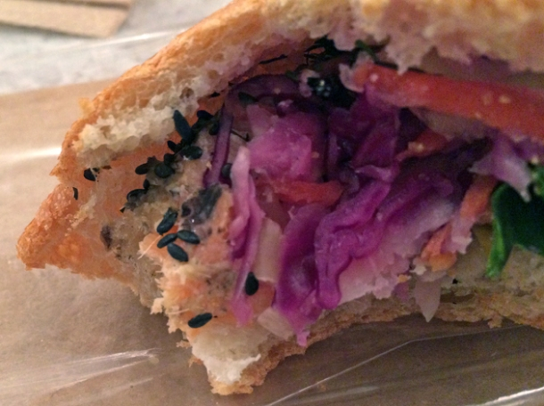 close up of salmon and toasted sesame banh mi at bep haus