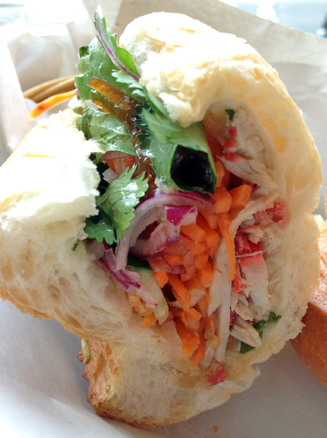 spiced pork and pork roll baguette at banh mi saigon
