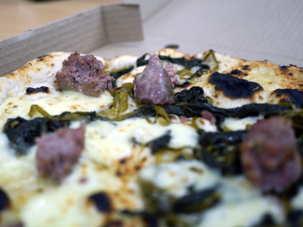 close up of broccoli, mozzarella and Gloucester old spot sausage pizza from franco manca