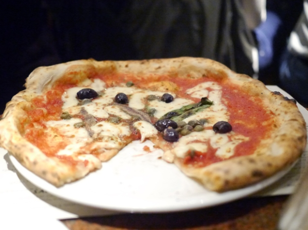 tomato, garlic, oregano, capers, olives, anchovies & mozzarella pizza at franco manca