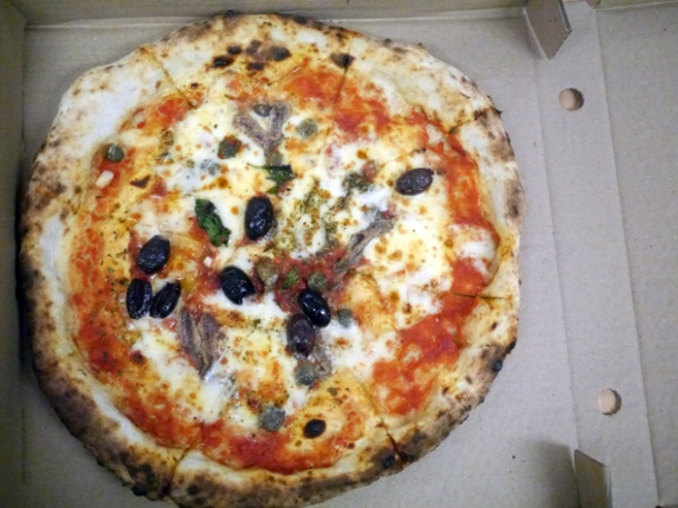 tomato, garlic, oregano, capers, olives, anchovies & mozzarella pizza from franco manca