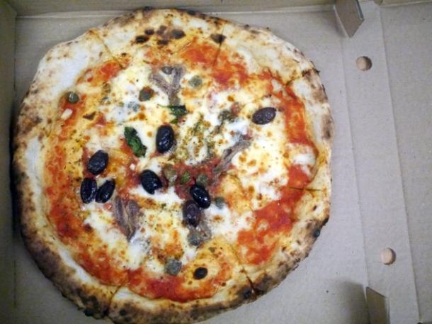 tomato, garlic, oregano, capers, olives, anchovies & mozzarella pizza from franco manca