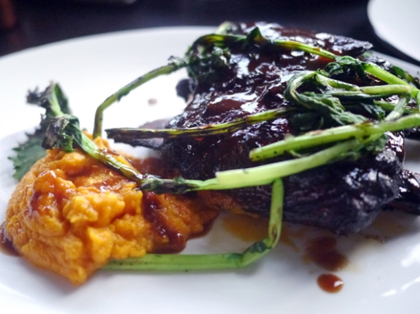 jacob's ladder ribs with butternut squash hummus at q grill