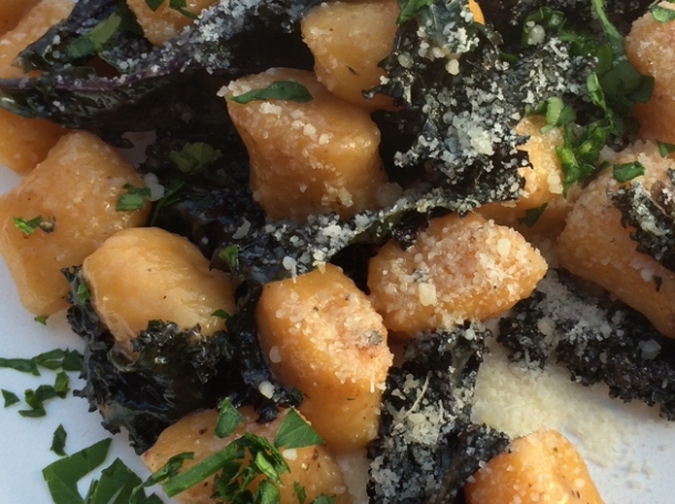 close up of pumpkin gnocchi with kale in truffle oil from pasta e basta