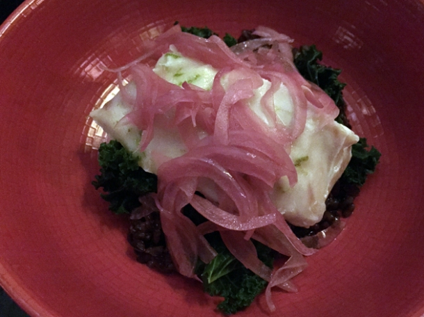 poached hake with pickled onion and black rice at tredwells