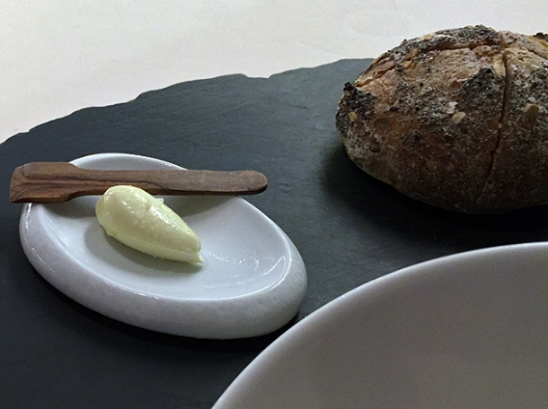 pumpkin seed bread with olive oil cream at metamorfosi