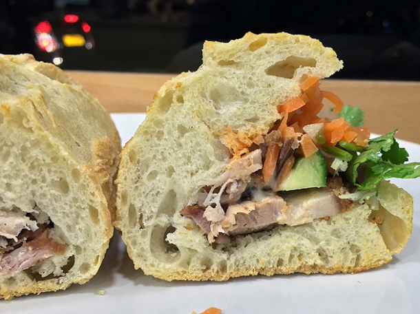crispy pork belly banh mi at carrots and daikon