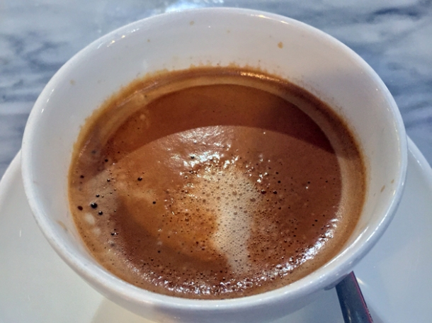 flat white coffee at the perfectionists' cafe heathrow terminal 2