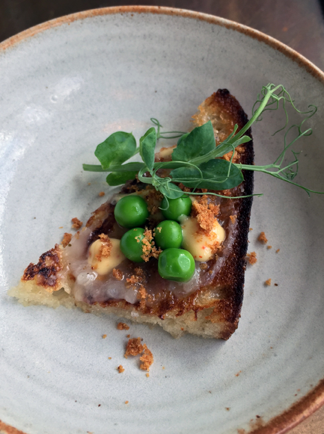 lardo and peas on sourdough at pidgin