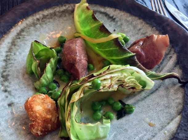 lamb rump with sweetbread, cabbage, peas at paradise garage