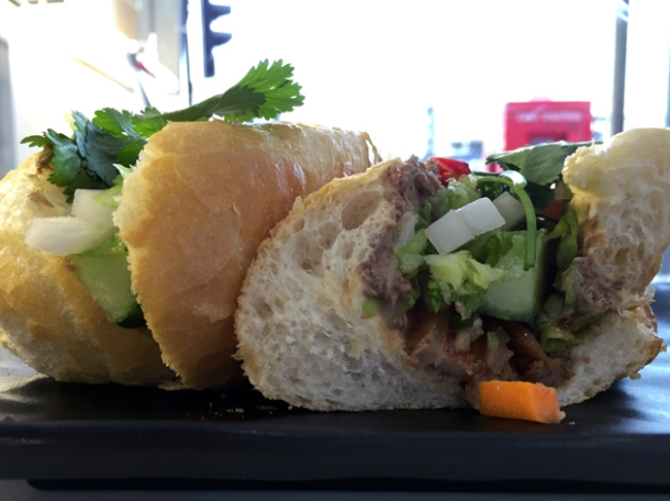pork belly with wild boar pate banh mi at oi hanoi