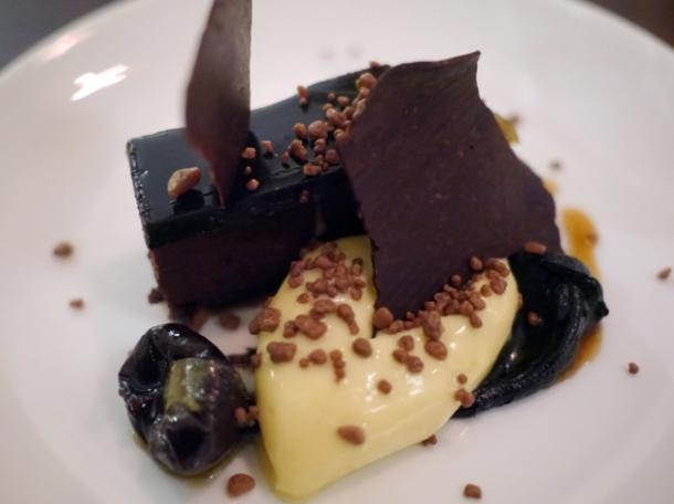chocolate, prune and cardamom delice, bergamot cream and praline at oklava