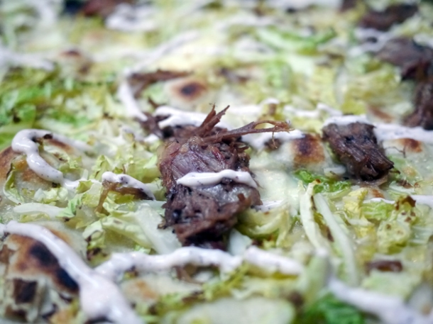 goat shoulder, cabbage and yoghurt pizza at homeslice fitzrovia
