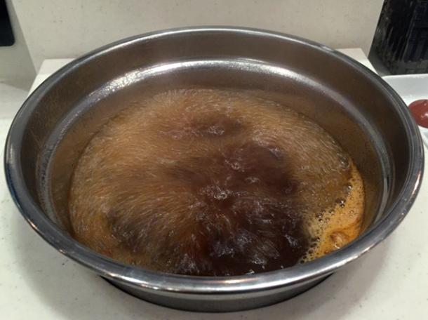 boiling mala chinese hotpot broth at shuang shuang