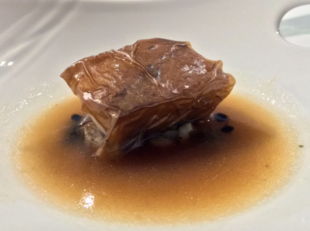 sea bream in squid skin and squid sauce at biko