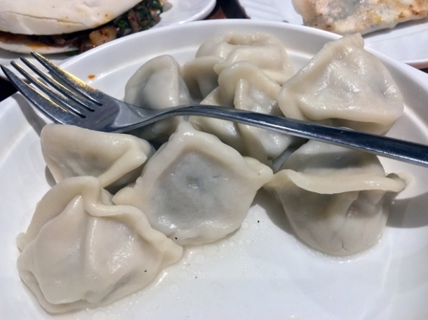 steamed pork and vegetable dumplings at xi'an impression