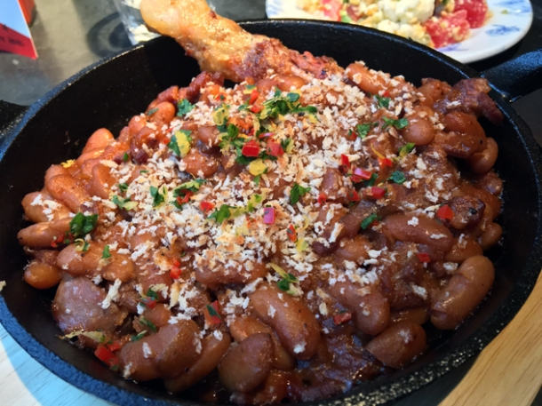 beans, smoked toulouse sausage and confit duck leg at bukowski grill soho