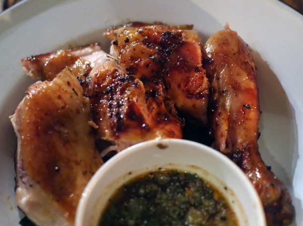 grilled chicken leg with tamarind dipping sauce at som saa whitechapel
