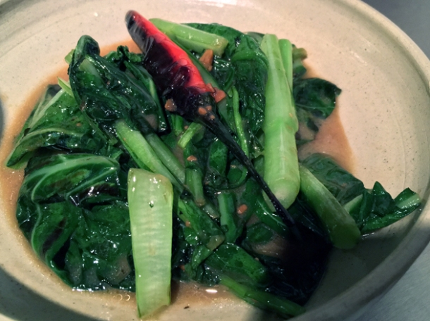 stir fried greens in soy sauce at kiln