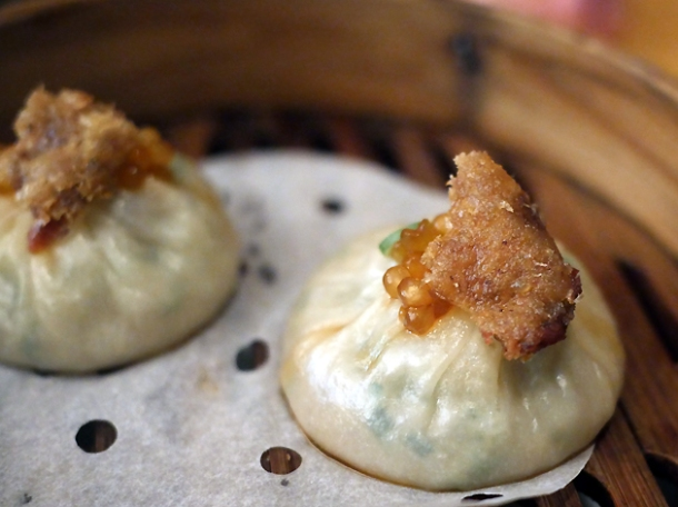 xiao long bao topped with crispy duck skin at a wong