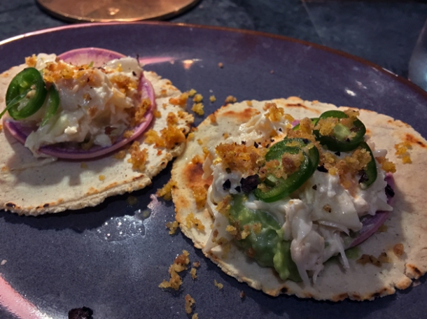 crab and pickled onion pork skin tacos at temper
