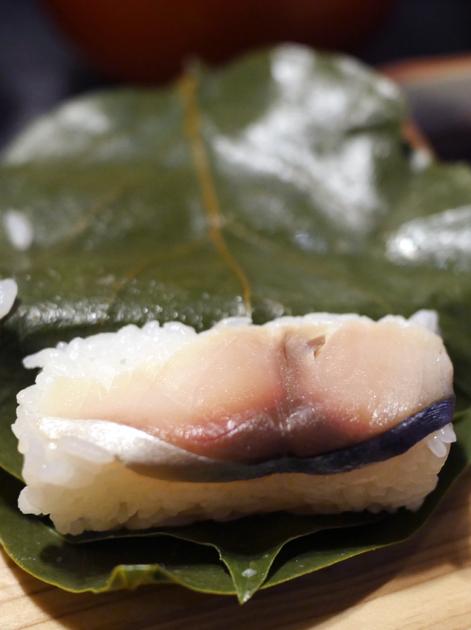 persimmon wrapped mackerel sushi nigiri roll at hiraso nara