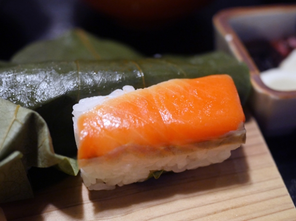 persimmon wrapped salmon sushi nigiri roll at hiraso nara