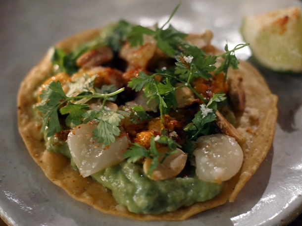 sea urchin and scallop tostada at breddos tacos