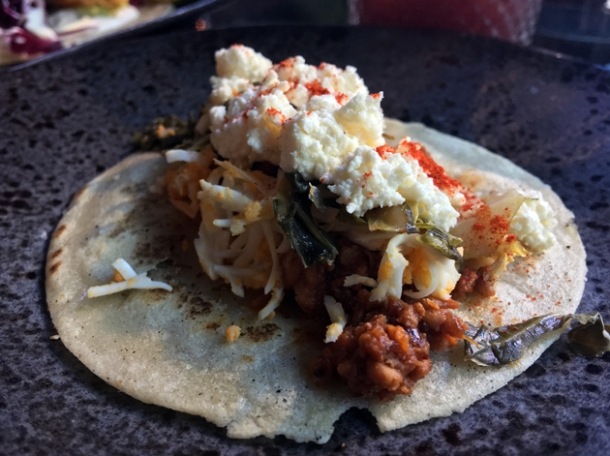 addis doro wat chicken and collard green tacos with goat's cheese at tienda roosteria